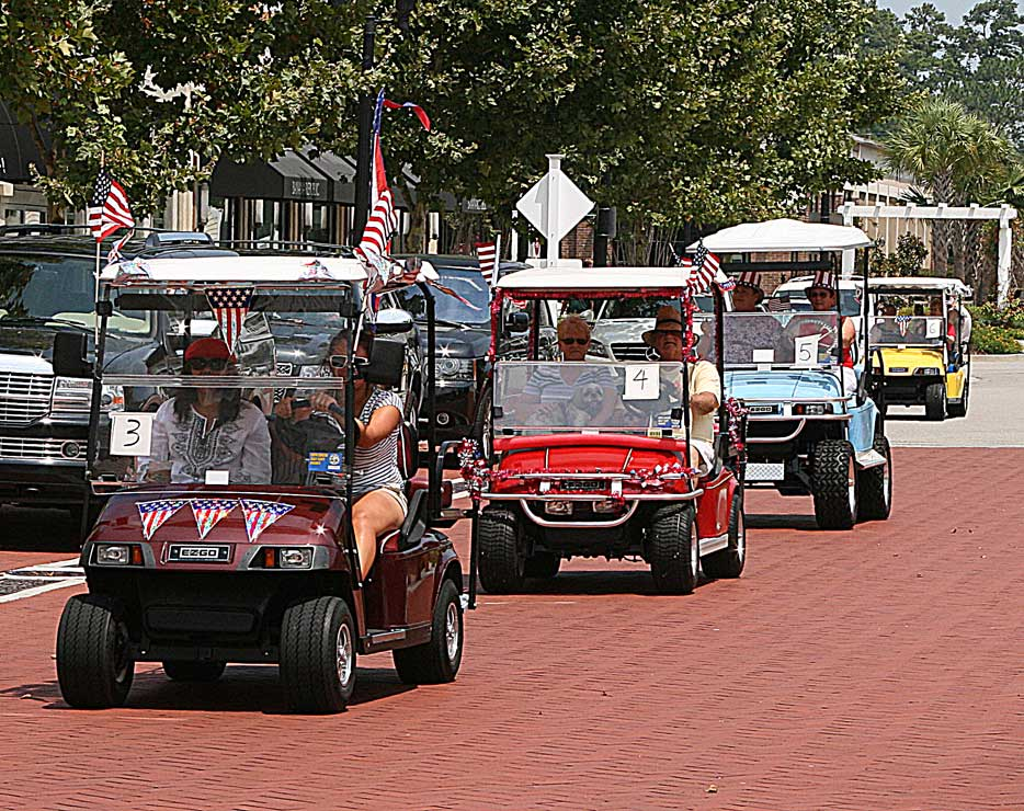 View the seagate village july 4th golf cart parade through the market